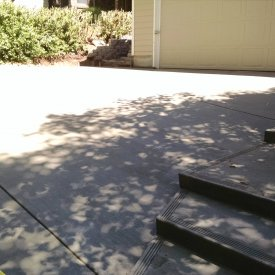 concrete driveway with stairs